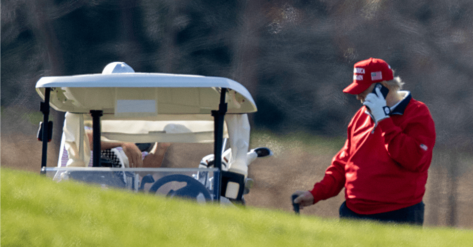 President Donald Trump makes a phone call as he golfs at Trump National Golf Club on November 26, 2020 in Sterling, Virginia.